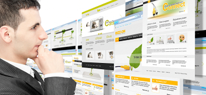 Business man looking at multiple responsive website screens